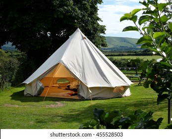 Traditional canvas bell tent in english countryside
