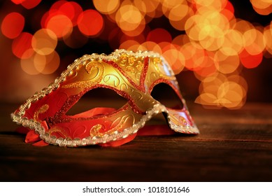 Traditional carnival mask over holiday lights  background