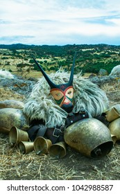 Traditional carnivale masks of the Boes e Merdules with a countryside view in the background, Ottana, Sardinia, Italy, Europe