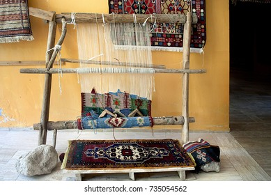 a traditional carpet weaving loom in a remote village outside of Pammukale, Turkey.