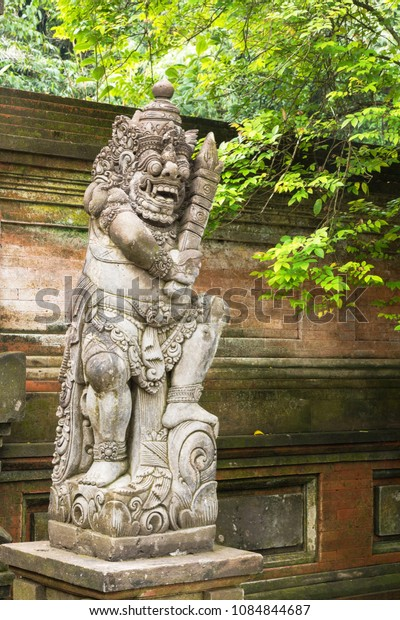Traditional carved statue demon guards statue in Bali
