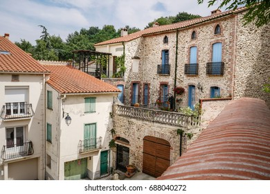 Traditional catalan village in south of France with typical houses with colored windows and shutters, lovely and romantic place