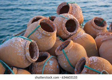 Traditional ceramic pots for catching octopus in Portugal harbor