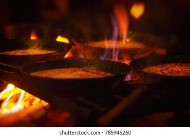 Traditional charcoal buns made over an open fire on iron pans in a hut. Harjedalen, Sweden