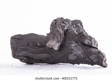 Traditional charcoal wood with white background.