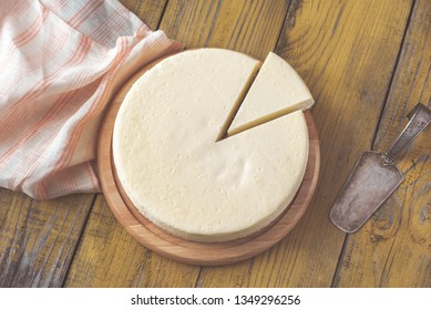 Traditional cheesecake on the wooden table flat lay
