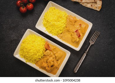 Traditional chicken butter masala with jasmine rice and chapati