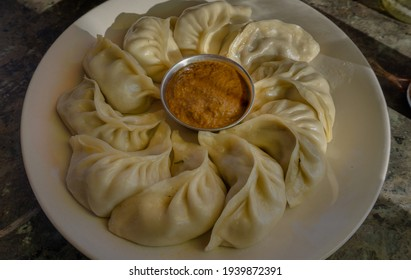 Traditional chicken momo with peanut sauce from Nepal