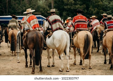 "Traditional chilean event full of horses and horse man called ""huasos"""