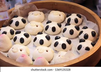 Traditional Chinese animal-shaped mantou buns - pandas and pigs