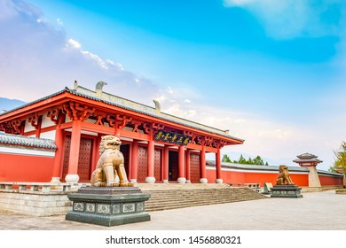 Traditional Chinese architecture and guardian lion. The text on the board translated into English is Chongsheng Temple Three Pagodas. Located in Dali, Yunnan, China.