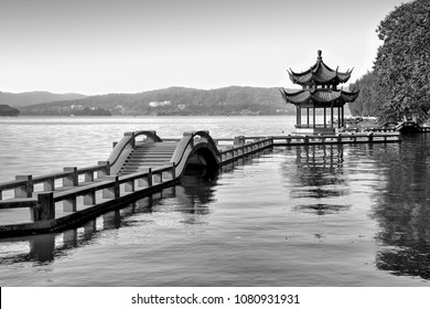Traditional chinese bridge and pavilion on Hangzhou lake, China - Black and white