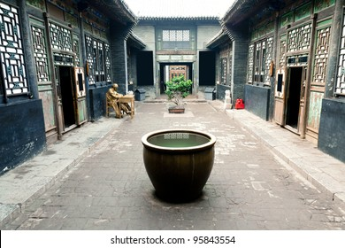 Traditional Chinese Building. A big vat placed in the yard for fireproofing, another meaning is collecting wealth. Water means wealth intraditional culture.