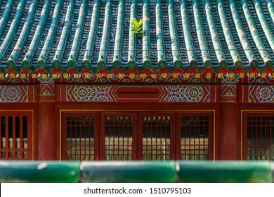 A traditional Chinese building in Ditan, China. The building has green roof and red walls.