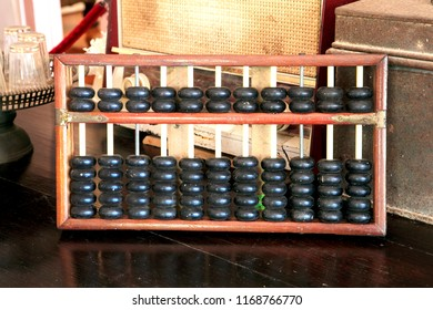 Traditional Chinese Calculator or abacus on an Old wood table