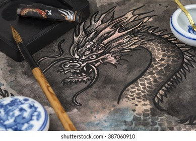 Traditional Chinese calligraphy brush and block ink dragon painting