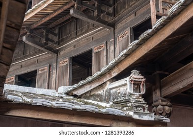 Traditional chinese carvings on roof at Tulou at Unesco heritage site near Xiamen