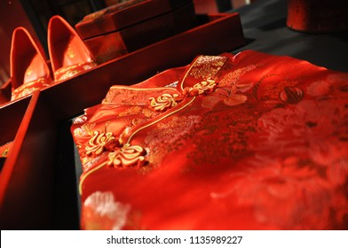 Traditional Chinese Cheongsam on table, folded nicely, with chinese button and bokeh close up shot