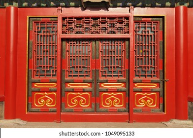 Traditional Chinese doors in The Palace Museum (Forbidden City) located in Beijing, China.