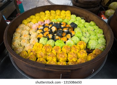 traditional chinese dumplings for sale in bamboo steamer