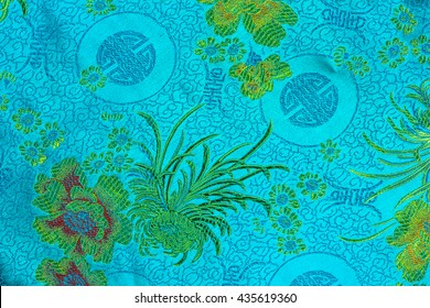 Traditional Chinese fabric blue with a floral pattern