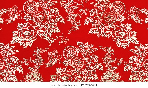 Traditional Chinese floral print pattern on red fabric