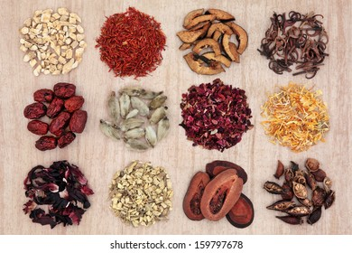 Traditional chinese herbal medicine selection over papyrus background.