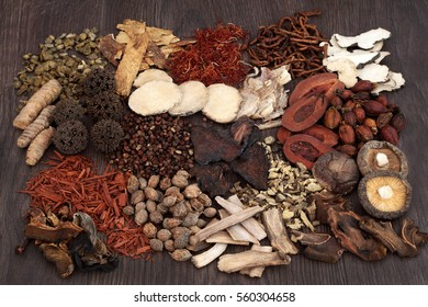 Traditional chinese herbs used in alternative herbal medicine selection on oak background.