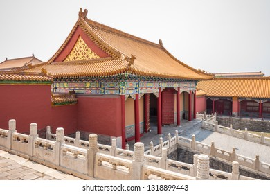 Traditional Chinese house with red doors with decorations and columns.