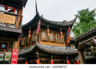 "The traditional Chinese house with red and yellow lamps on Jin Li street. Chengdu, Sichuan. Translation is ""The house at mountain top""."