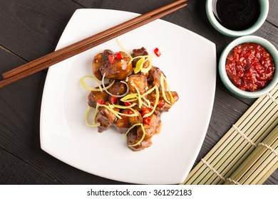 Traditional chinese kung pao fried chicken with vegetables and sauce