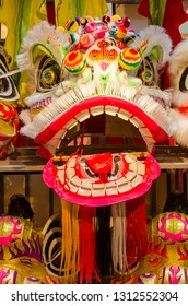 Traditional chinese lion dance head display on the shelves.