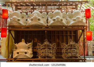 Traditional chinese lion dance head mold display on the shelves.
