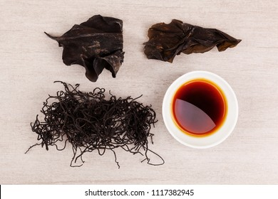Traditional chinese medicine seaweed and Dan Shen on white background. TCM top view.