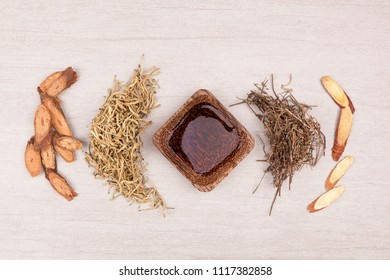 Traditional chinese medicine tea help to stop cough. TCM on gray background top view.