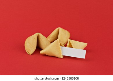 Traditional  Chinese new year fortune cookies on red background with white paper for text