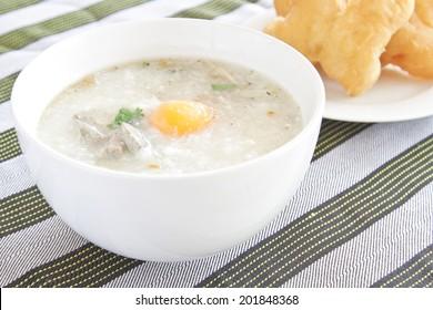 Traditional chinese porridge rice gruel in white bowl, congee.