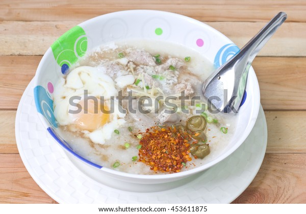 Traditional chinese porridge rice gruel in bowl.