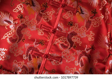 Traditional Chinese red fabric with red knot buttons on silk dragon patterns