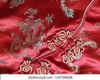 traditional Chinese Red knot buttons on silk dress with beautiful patterns