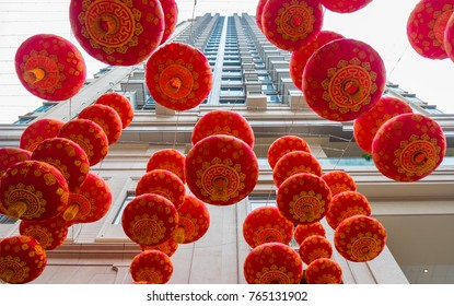 Traditional Chinese Red Lanterns On Skyscrapers Background. Contrast Of Ancient Traditions And Modern Life In South East Asia. China New Year Concept.