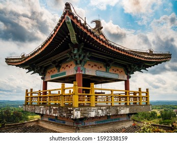 A traditional Chinese roofed pavilion / pagoda on a high mountain in Hainan, China, built in the ancient classical Chinese architecture style.