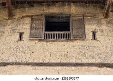 Traditional chinese shutters on window at Tulou at Unesco heritage site near Xiamen