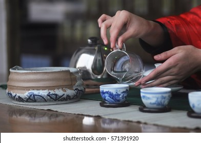 Traditional chinese tea preparation process (ceremony) in Chengdu, China. Pouring warm water into the bowl. (Selective focusing)