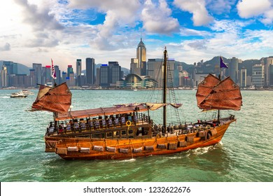 Traditional Chinese wooden sailing ship in Victoria Harbour in Hong Kong at summer day