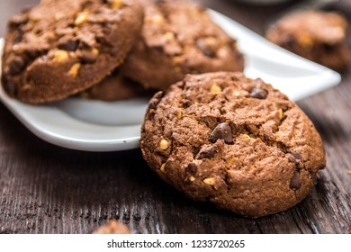 Traditional chocolate chip cookies  on wood table