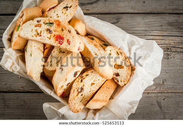 Traditional Christmas baking biscotti or cantucci in a basket on a wooden table, copy space.