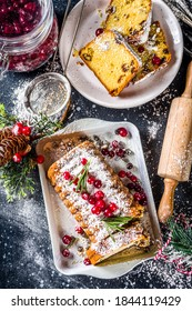 Traditional christmas baking, Festive Xmas fruitcake with dryed fruits, liquer, and cranberry decor. Homemade fruitcake on Chritmas decorated background