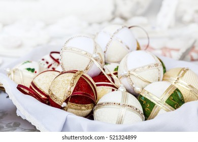Traditional christmas balls with fabric textile, pearls and ornaments