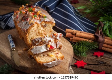 Traditional Christmas cake with candied fruit, raisins and fruits. Selective focus.